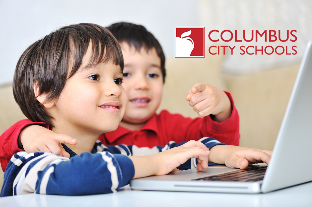 Boys using a laptop computer at school_with CCS logo-1